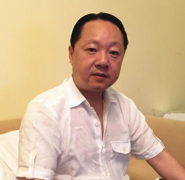 北京迷你世界文化交流有限公司董事长汪忠文接受采访 记者 吴礼明 摄
